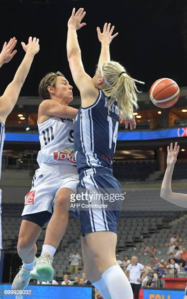 CORRECTION France's Celine Dumerc and Slovakia's Marie Ruzickova vie for the ball during the FIBA EuroBasket 2017 women's quarterfinal match between...