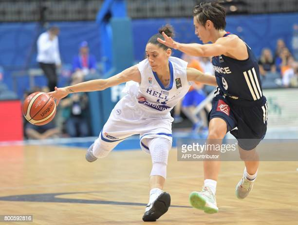 France's Celine Dumerc blocks Angeliki Nikolopoulou of Greece during during the FIBA EuroBasket 2017 women's semifinal match between Greece and...