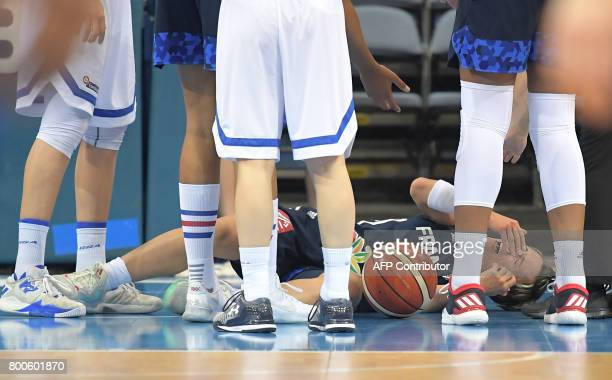 France's Celine Dumerc lays down after been injured during the FIBA EuroBasket 2017 women's semifinal match between Greece and France in Prague on...