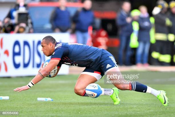 France's center Gael Fickou scores a try during the International Six Nations rugby union match Italy vs France on March 11 2017 at the Olympic...