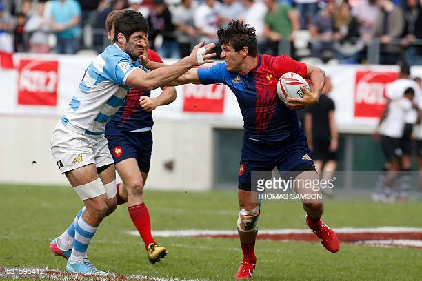 France's center Jeremy Aicardi fights for the ball during the HSBC Paris Sevens Series Third place final rugby match between Argentina and France at...