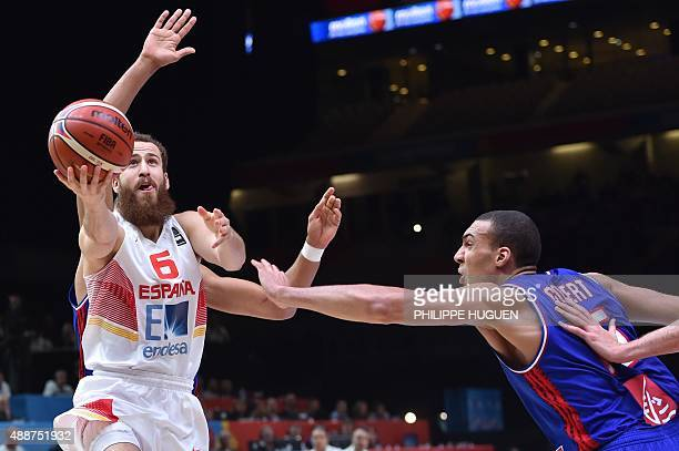 France's center Rudy Gobert defends against Spain's point guard Sergio Rodriguez during the semifinal basketball match between Spain and France at...
