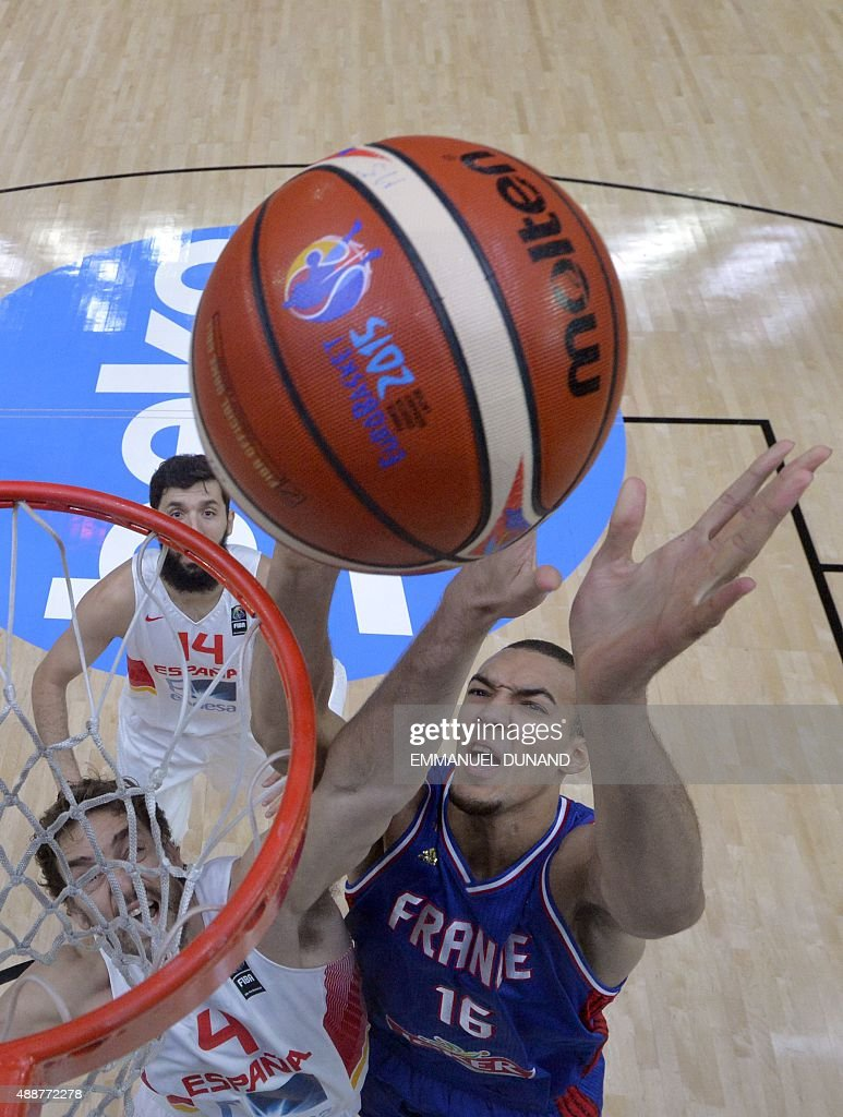 France's center Rudy Gobert goes to the basket DESPITE Spain's center Pau Gasol during the semifinal basketball match between Spain and France at the...