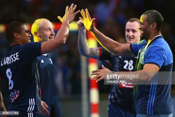 TOPSHOT France's centre back Daniel Narcisse France's goalkeeper Thierry Omeyer France's right back Valentin Porte and France's head coach Didier...