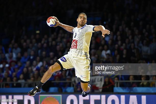 France's centre back Daniel Narcisse jumps to shoot during the 25th IHF Men's World Championship 2017 Group A handball match Japan vs France on...