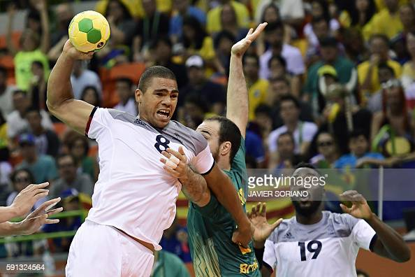 TOPSHOT France's centre back Daniel Narcisse vies with Brazil's centre back Henrique Teixeira during the men's quarterfinal handball match Brazil vs...