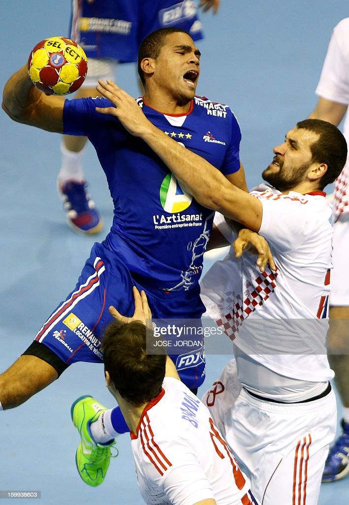 France's centre back Daniel Narcisse vies with Croatia's pivot Zeljko Musa during the 23rd Men's Handball World Championships quarterfinal match...