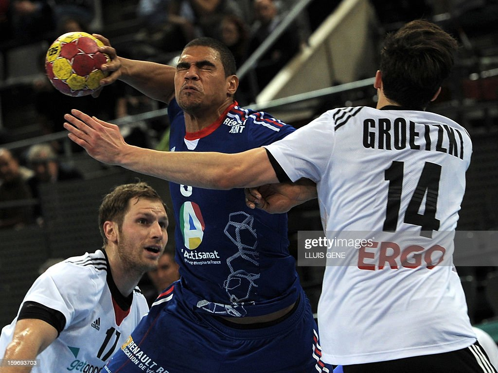France's centre back Daniel Narcisse (C) vies with Germany's right wing Patrick Groetzki (R) and Germany's right wing Steffen Weinhold (L) during the 23rd Men's Handball World Championships preliminary round Group A match France vs Germany at the Palau Sant Jordi in Barcelona on January 18, 2013. AFP PHOTO/ LLUIS GENE