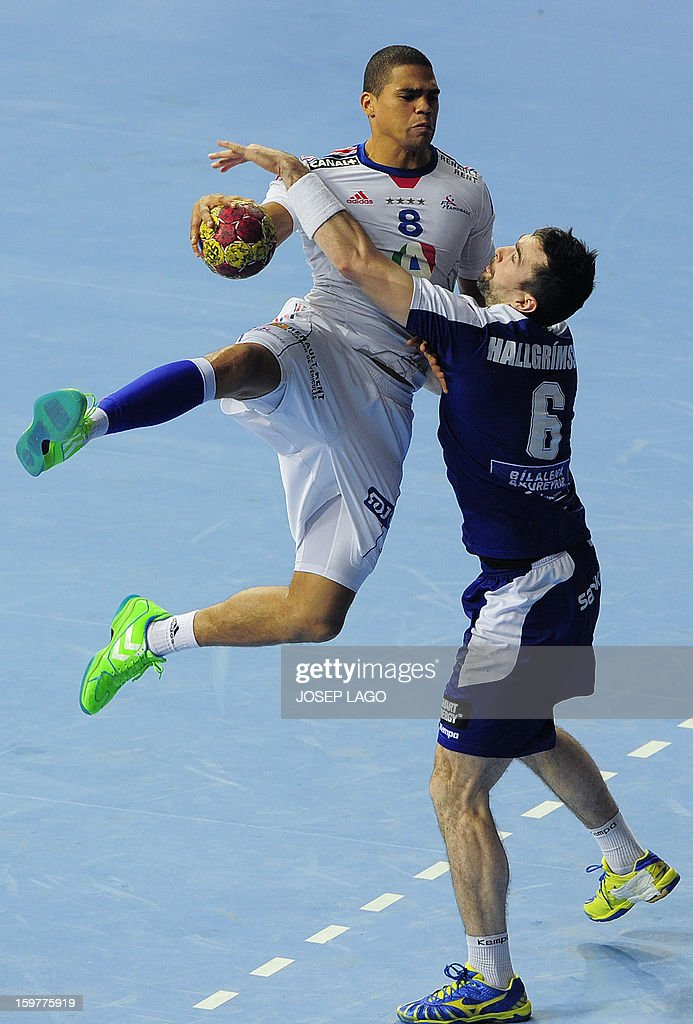 France's centre back Daniel Narcisse (L) vies with Iceland's right wing Asgeir Orn Hallgrimsson (R) during the 23rd Men's Handball World Championships round of 16 match Iceland vs France at the Palau Sant Jordi in Barcelona on January 20, 2013. AFP PHOTO / JOSEP LAGO