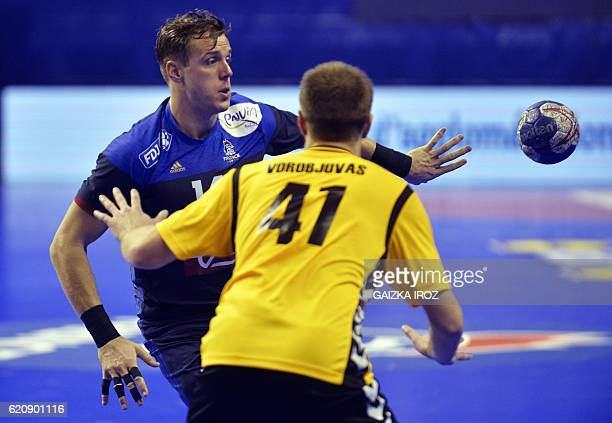 France's centre back Kentin Mahe passes the ball and vies with Lithuania's right back Edvinas Vorobjovas during the 2018 EHF Men's European Handball...