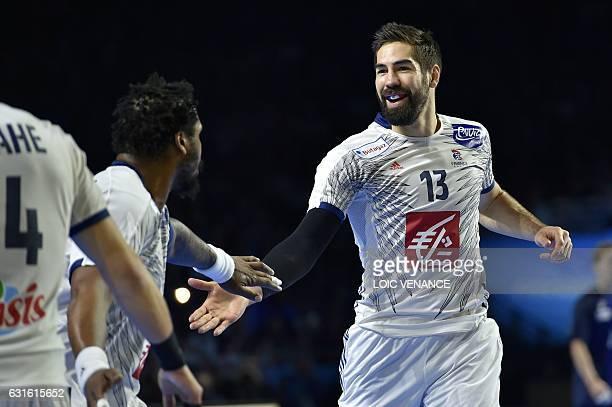 France's centre back Nikola Karabatic celebrates after scoring a goal during the 25th IHF Men's World Championship 2017 Group A handball match Japan...