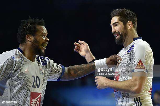 France's centre back Nikola Karabatic celebrates after scoring a goal with his teammate France's pivot Cedric Sorhaindo during the 25th IHF Men's...