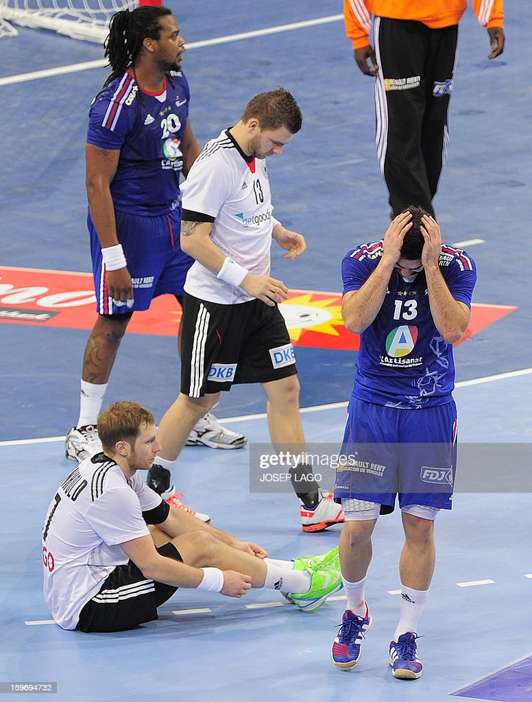 France's centre back Nikola Karabatic (R) gestures during the 23rd Men's Handball World Championships preliminary round Group A match France vs Germany at the Palau Sant Jordi in Barcelona on January 18, 2013. Germany won 32-30.