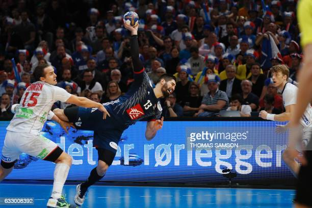 TOPSHOT France's centre back Nikola Karabatic jumps to shoot on goal and score during the 25th IHF Men's World Championship 2017 final handball match...