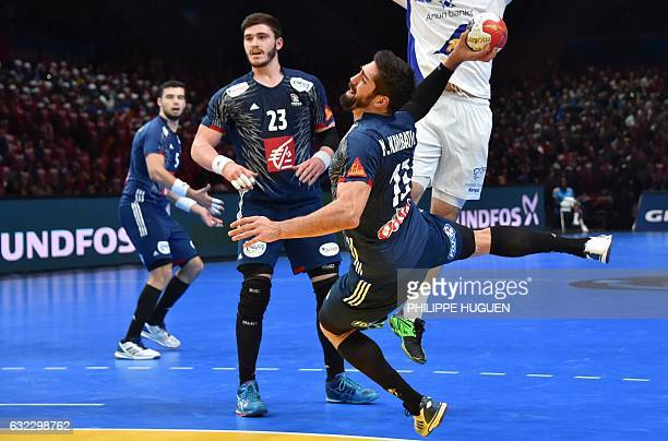 France's centre back Nikola Karabatic jumps to shoot on goal during the 25th IHF Men's World Championship 2017 eighth final handball match France vs...