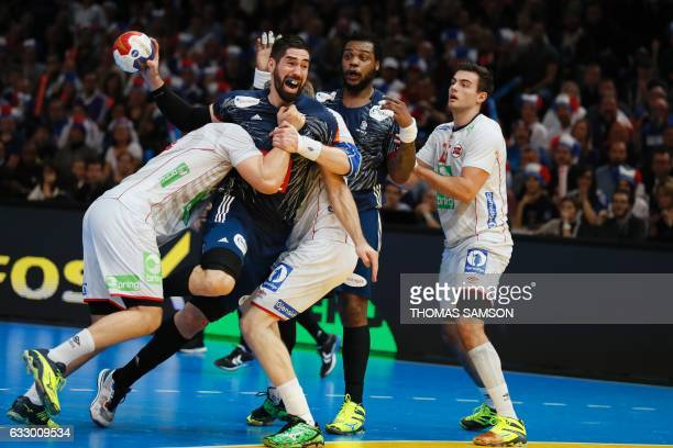 TOPSHOT France's centre back Nikola Karabatic prepares to shoot amd score during the 25th IHF Men's World Championship 2017 final handball match...