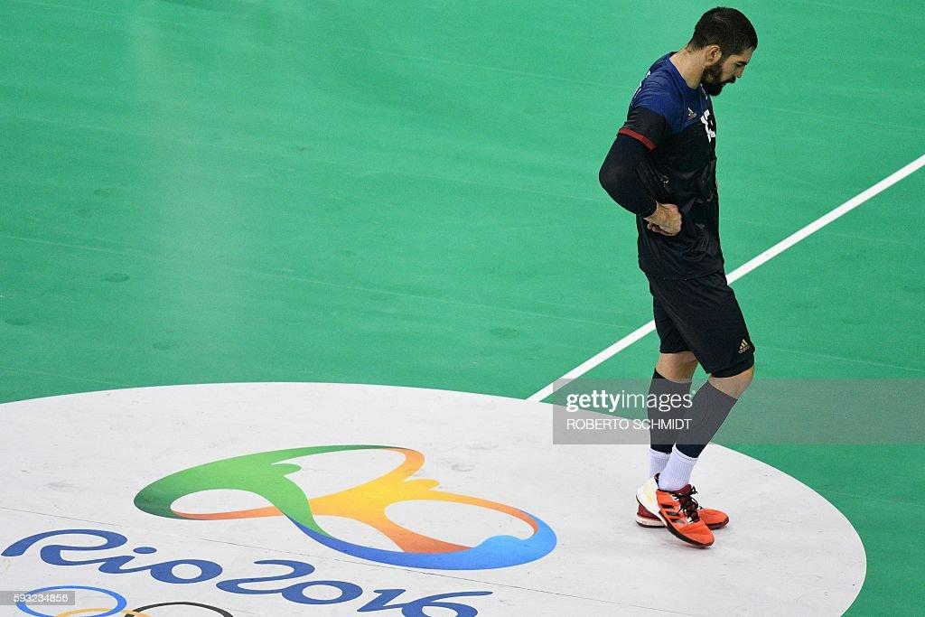 TOPSHOT France's centre back Nikola Karabatic reacts during the men's Gold Medal handball match Denmark vs France for the Rio 2016 Olympics Games at...