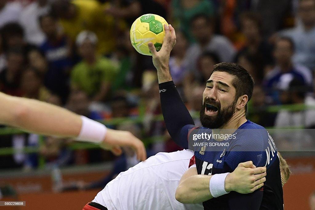 TOPSHOT France's centre back Nikola Karabatic vies with a Danish player during the men's Gold Medal handball match Denmark vs France for the Rio 2016...