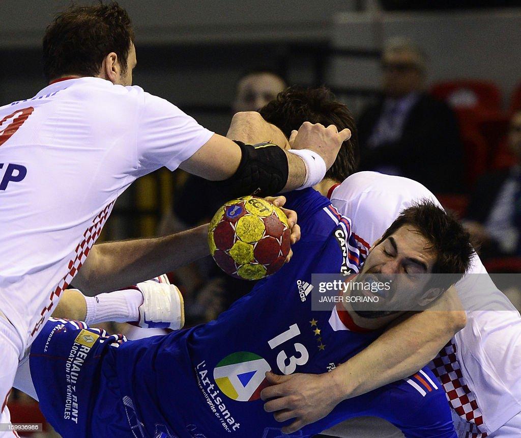 France's centre back Nikola Karabatic vies with Croatian during the 23rd Men's Handball World Championships quarterfinal match France vs Croatia at...