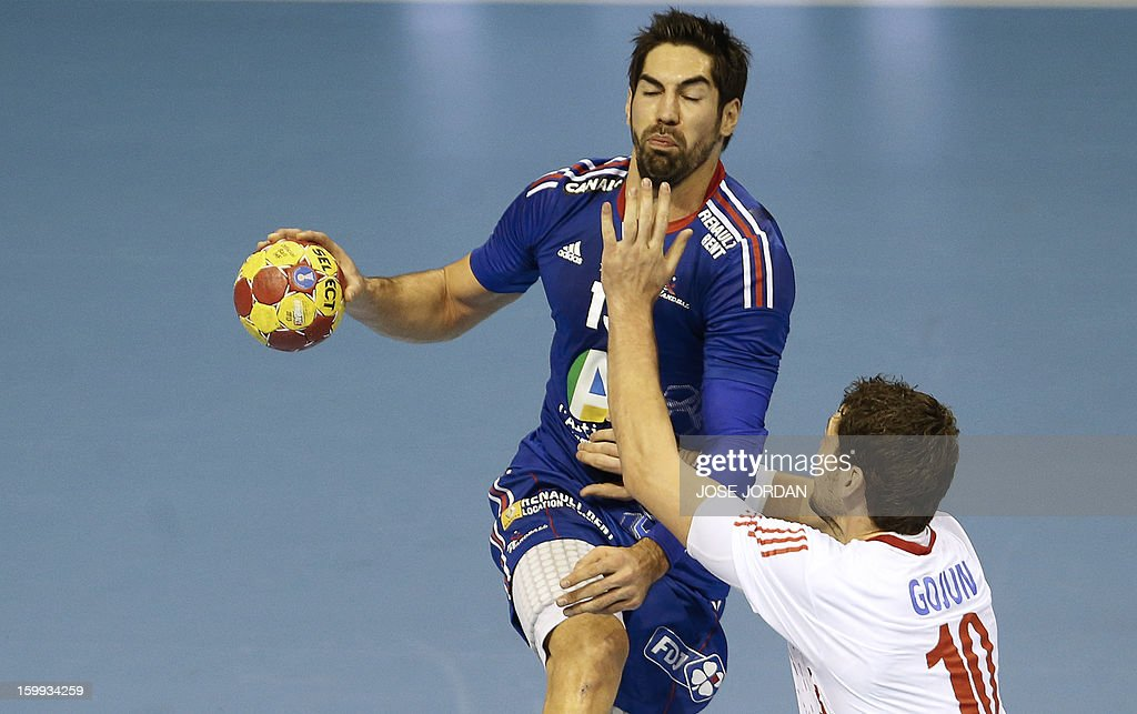France's centre back Nikola Karabatic vies with Croatia's left back Jakov Gojun during the 23rd Men's Handball World Championships quarterfinal match...