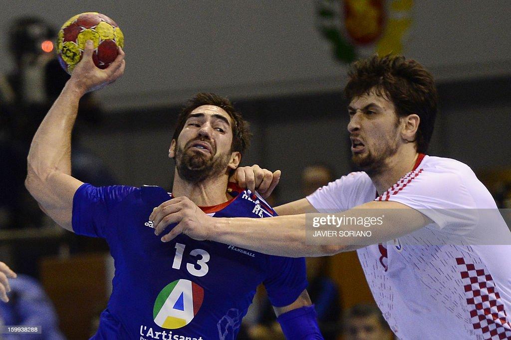 France's centre back Nikola Karabatic vies with Croatia's right back Marko Kopljar during the 23rd Men's Handball World Championships quarterfinal...