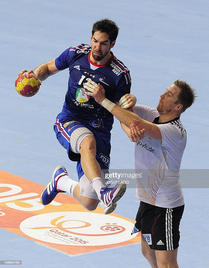 France's centre back Nikola Karabatic (L) vies with Germany's pivot Oliver Roggisch (R) during the 23rd Men's Handball World Championships preliminary round Group A match France vs Germany at the Palau Sant Jordi in Barcelona on January 18, 2013.
