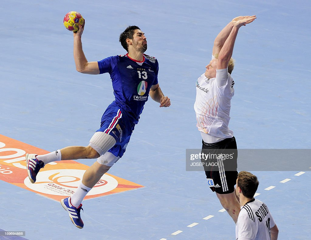 France's centre back Nikola Karabatic (L) vies with Germany's pivot Patrick Wiencek (R) during the 23rd Men's Handball World Championships preliminary round Group A match France vs Germany at the Palau Sant Jordi in Barcelona on January 18, 2013.