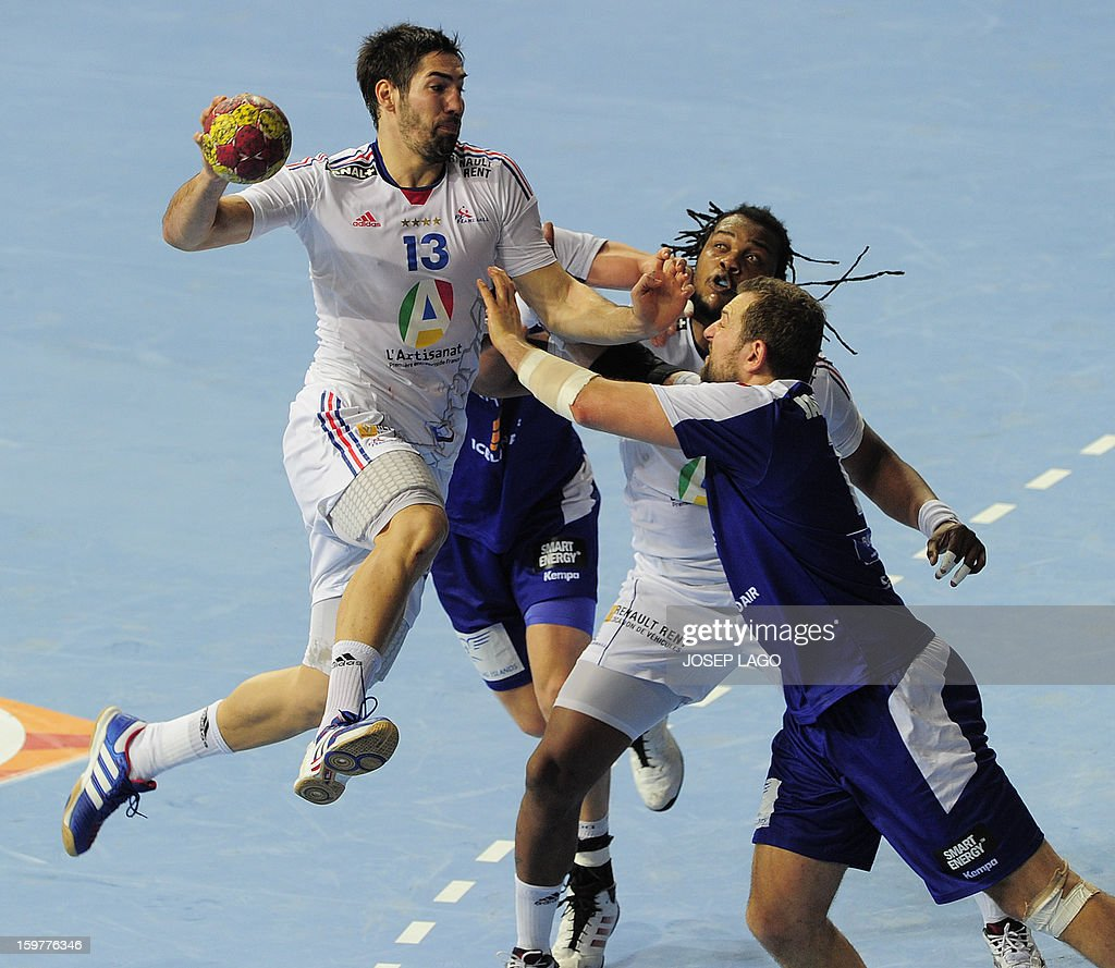 France's centre back Nikola Karabatic (L) vies with Iceland's pivot Sverre Jakobsson (R) during the 23rd Men's Handball World Championships round of 16 match Iceland vs France at the Palau Sant Jordi in Barcelona on January 20, 2013.