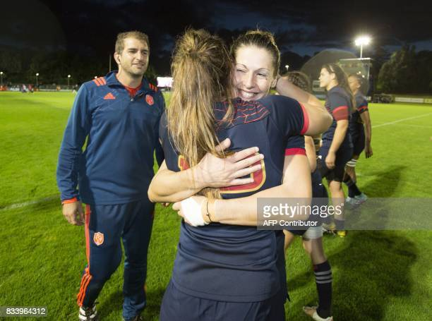 France's centre Elodie Poublan celebrates with France's centre Caroline Ladagnous on the pitch after the Women's Rugby World Cup 2017 pool C rugby...