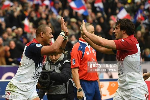 France's centre Gael Fickou celebratesw after scoring a try with his teammate France's flanker Kevin Gourdon during the Six Nations international...