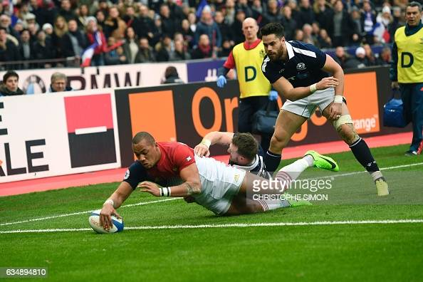 France's centre Gael Fickou scores a try during the Six Nations international rugby union match between France and Scotland at the Stade de France in...