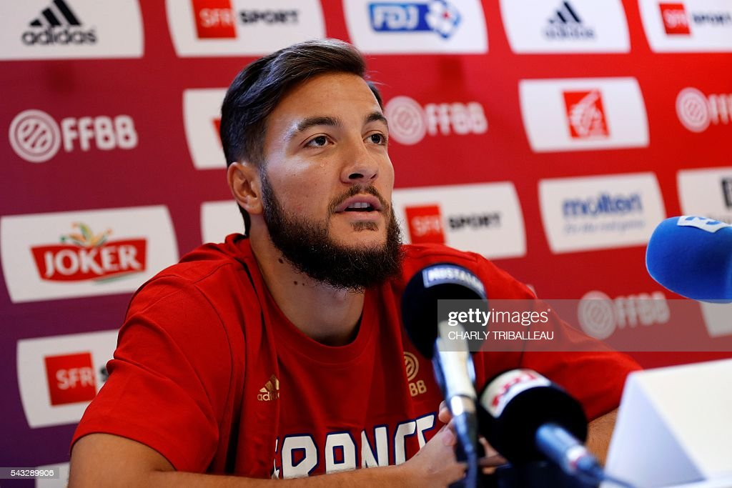 France's centre Joffrey Lauvergne speaks during a press conference on June 27, 2016 in Rouen, northwestern France a day before the basketball match between France and Japan. / AFP / CHARLY