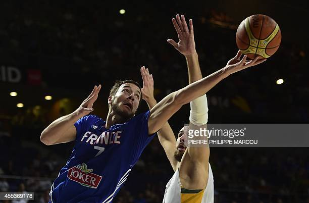 France's centre Joffrey Lauvergne vies with Lithuania's centre Jonas Valanciunas during the 2014 FIBA World basketball championships 3rd Place match...