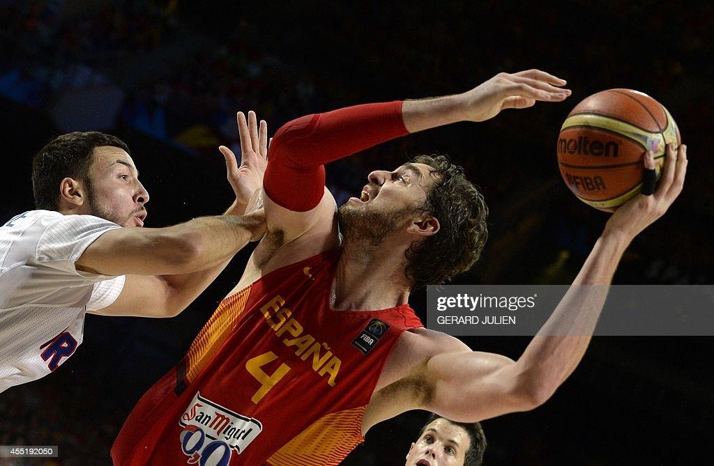 France's centre Joffrey Lauvergne vies with Spain's forward Pau Gasol during the 2014 FIBA World basketball championships quarterfinal match France...