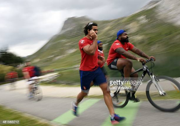 France's centre Mathieu Bastareaud and flanker Yoann Huget take part in a 'Run and Bike' session as part of the French rugby union team's training...
