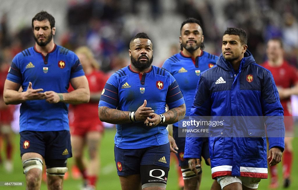 France's centre <a gi-track='captionPersonalityLinkClicked' href=/galleries/search?phrase=Mathieu+Bastareaud&family=editorial&specificpeople=677501 ng-click='$event.stopPropagation()'>Mathieu Bastareaud</a> (C) and France's centre <a gi-track='captionPersonalityLinkClicked' href=/galleries/search?phrase=Wesley+Fofana&family=editorial&specificpeople=6144061 ng-click='$event.stopPropagation()'>Wesley Fofana</a> (R) react after the Six Nations international rugby union match between France and Wales on February 28, 2015 at the Stade de France in Saint-Denis, north of Paris.