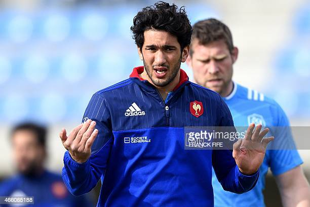 France's centre Maxime Mermoz gestures during a training session on March 13 2015 in Marcoussis south of Paris ahead of their Six Nations tournament...
