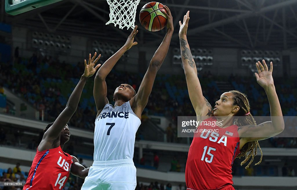 TOPSHOT France's centre Sandrine Gruda scores past USA's centre Brittney Griner during a Women's semifinal basketball match between France and USA at...
