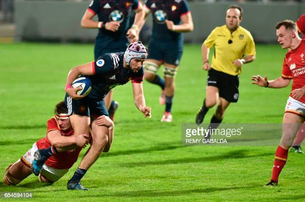 France's centre Theo Millet runs with the ball during the Six Nations U20 rugby match France versus Wales on March 17 2017 at the Sapiac Stadium in...