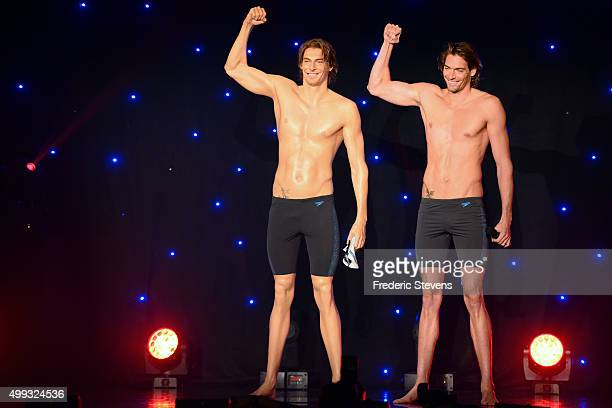 France's Champion swimmer Camille Lacourt poses next to his wax effigy during it's unveiling at Musee Grevin on November 30 2015 in Paris France