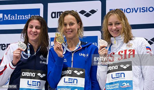 France's Charlotte Bonnet Italy's Federica Pellegrini and Russia's Veronika Popova pose with their medals of the 200 m Freestyle Women competition of...