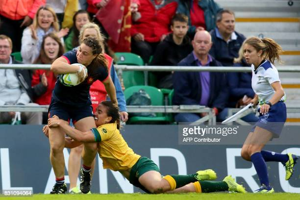 France's Chloe Pelle shakes off Australia's scrumhalf Katrina Barker to score another French try during the Women's Rugby World Cup 2017 pool C rugby...