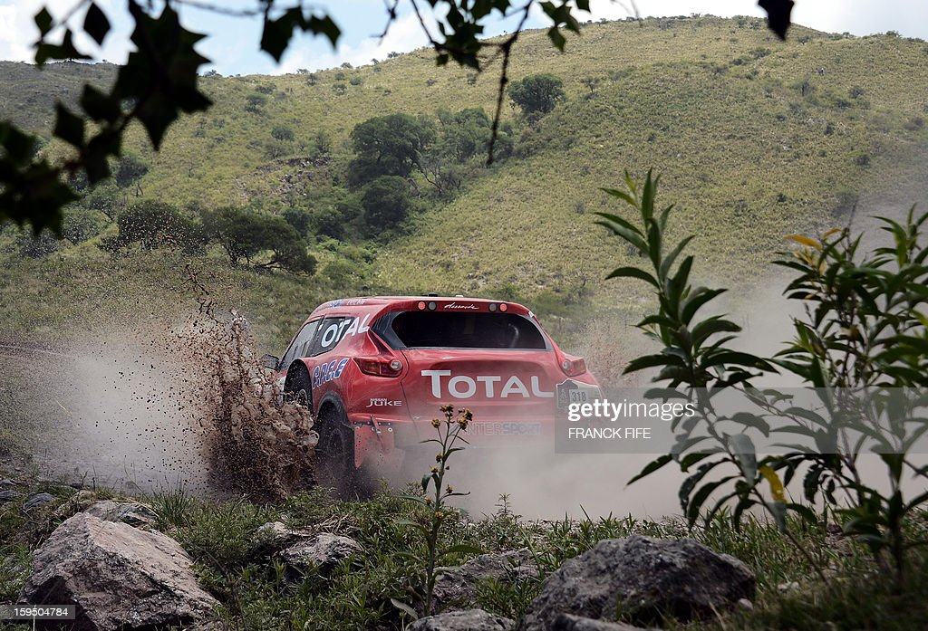 France's Christian Laveille competes on his Proto Dessoude during the Stage 9 of the Dakar 2013 between Tucuman and Cordoba, Argentina, on January 14, 2013. The rally takes place in Peru, Argentina and Chile between January 5 and 20. AFP PHOTO / FRANCK FIFE