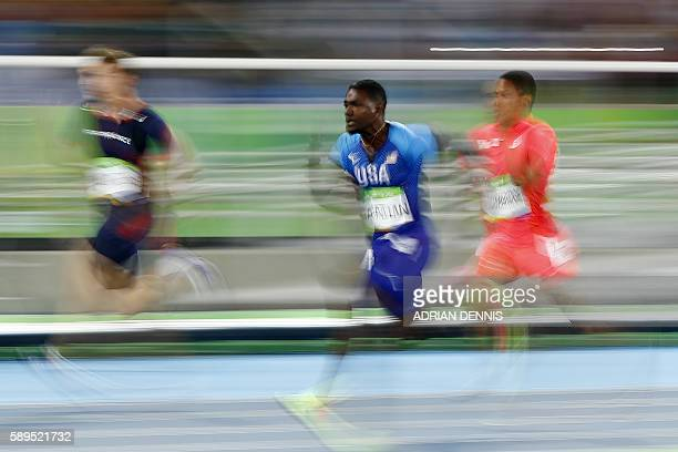 TOPSHOT France's Christophe Lemaitre USA's Justin Gatlin and Japan's Aska Cambridge compete in the Men's 100m Semifinal during the athletics event at...