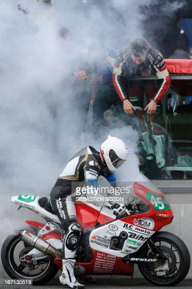 France's Christophe Michel of Metiss JLC Moto team does a burn out during the 77th Bol d'Or 24hour endurance motorbike race on April 21 2013 in...