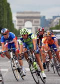 France's Christophe Moreau rides with The Netherlands' Michael Boogerd ride down the Champs Elysees during the 146 km twentieth and last stage of the...