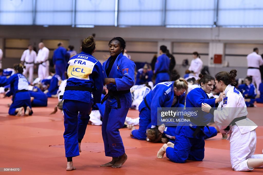 France's Clarisse Agbegnenou (C) and Automne Pavia take part in the international Paris Grand Slam 2016 training at the sporthall Carpentier in Paris on February 9, 2016. AFP PHOTO/MIGUEL MEDINA / AFP / MIGUEL MEDINA