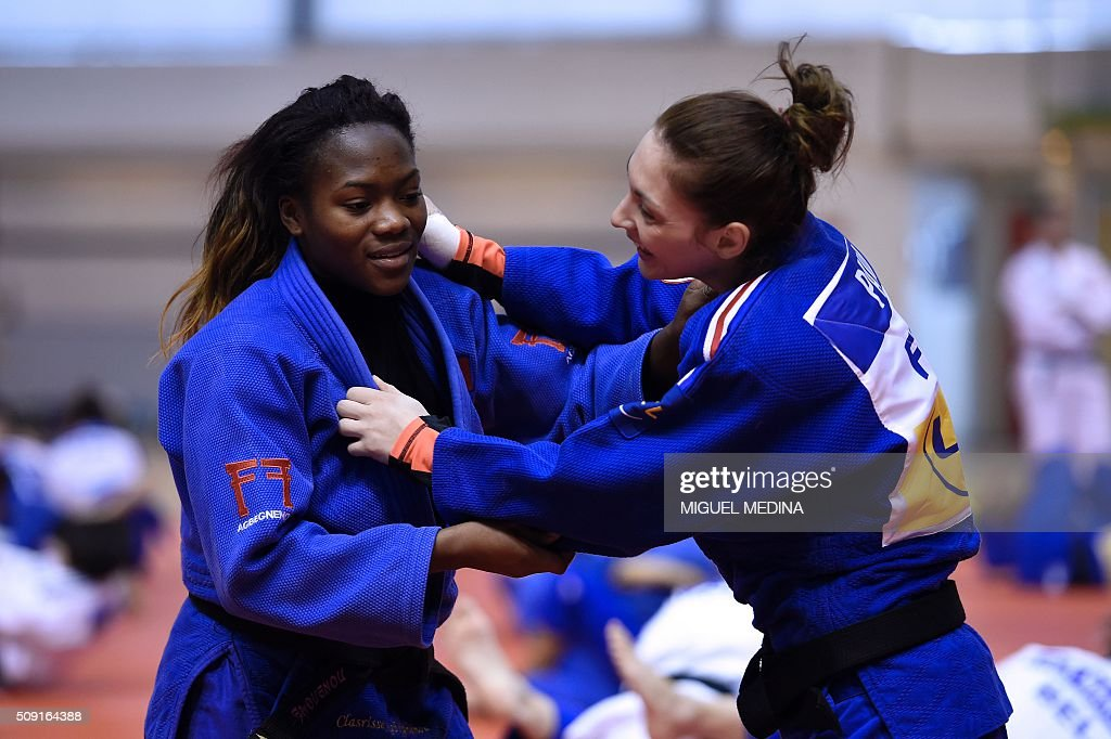 France's Clarisse Agbegnenou (L) and Automne Pavia take part in the international Paris Grand Slam 2016 training at the sporthall Carpentier in Paris on February 9, 2016. AFP PHOTO/MIGUEL MEDINA / AFP / MIGUEL MEDINA