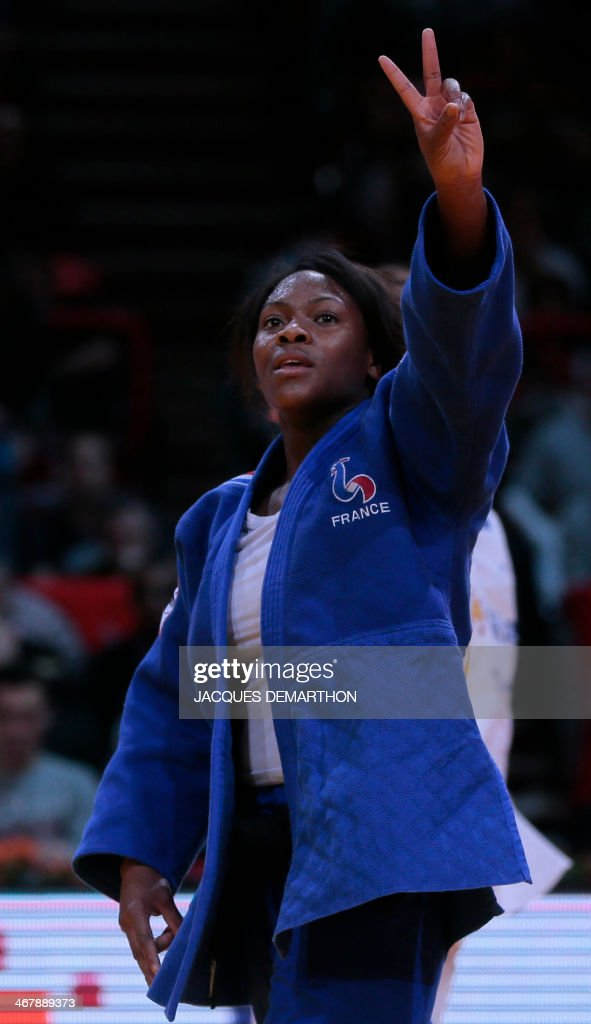 France's Clarisse Agbegnenou celebrates after winning her fight against France's AnneLaure Bellard in the 63 kg finals at the 2014 Paris Judo Grand...