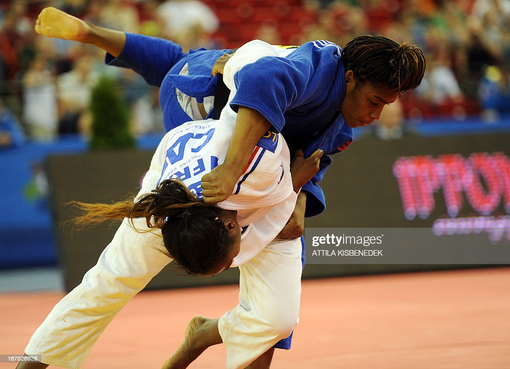 France's Clarisse Agbegnenou (white) figths with Italy's Edwige Gwend (blue) during the Judo European Championships in 63kg category for women in Budapest on April 26, 2013.